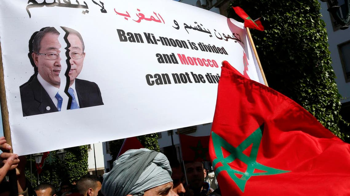 Protesters hold a banner and the Moroccan flag as they chant slogans during a rally, in Rabat, Morocco. (AP)