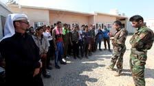 Civilians flee Iraq town as battle looms