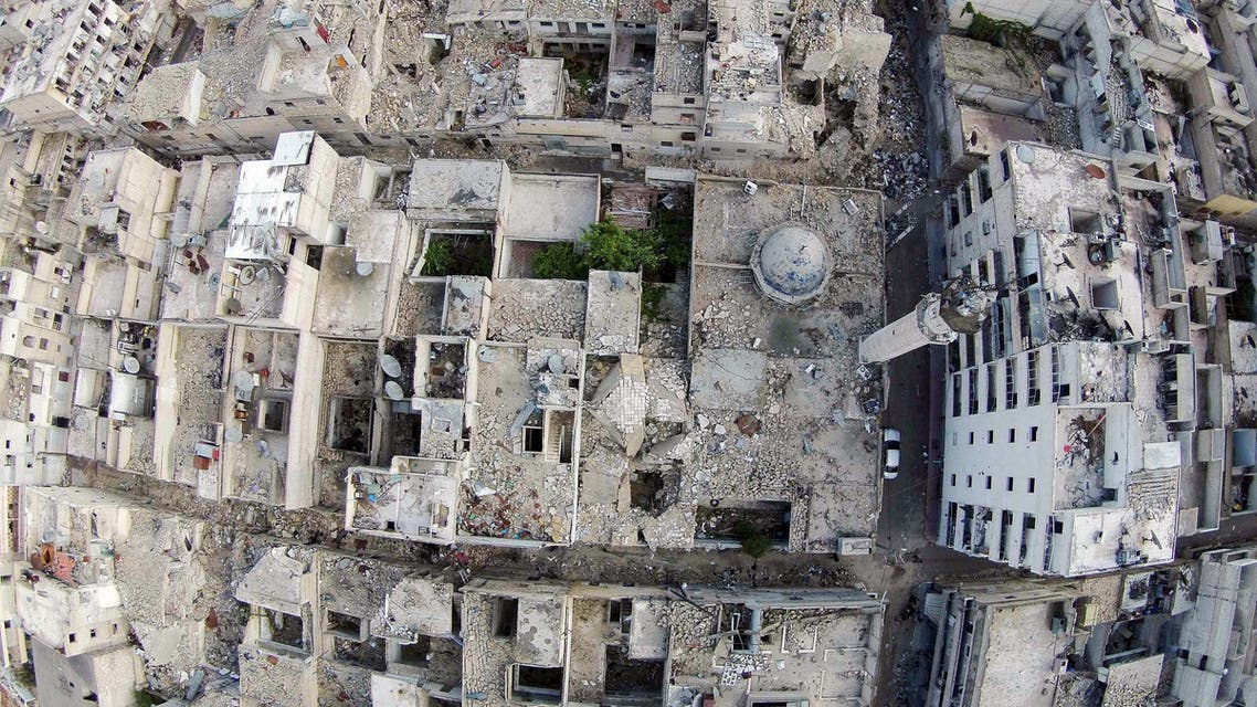 A aerial view shows a damaged mosque and surrounding buildings in the Al-Maysar neighbourhood of Aleppo, April 23, 2015. (Reuters)