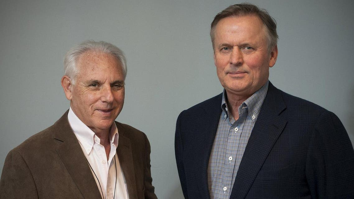 Author John Grisham and Neal Kassell are seen in an undated handout picture courtesy of the Focused Ultrasound Foundation. (via Reuters)