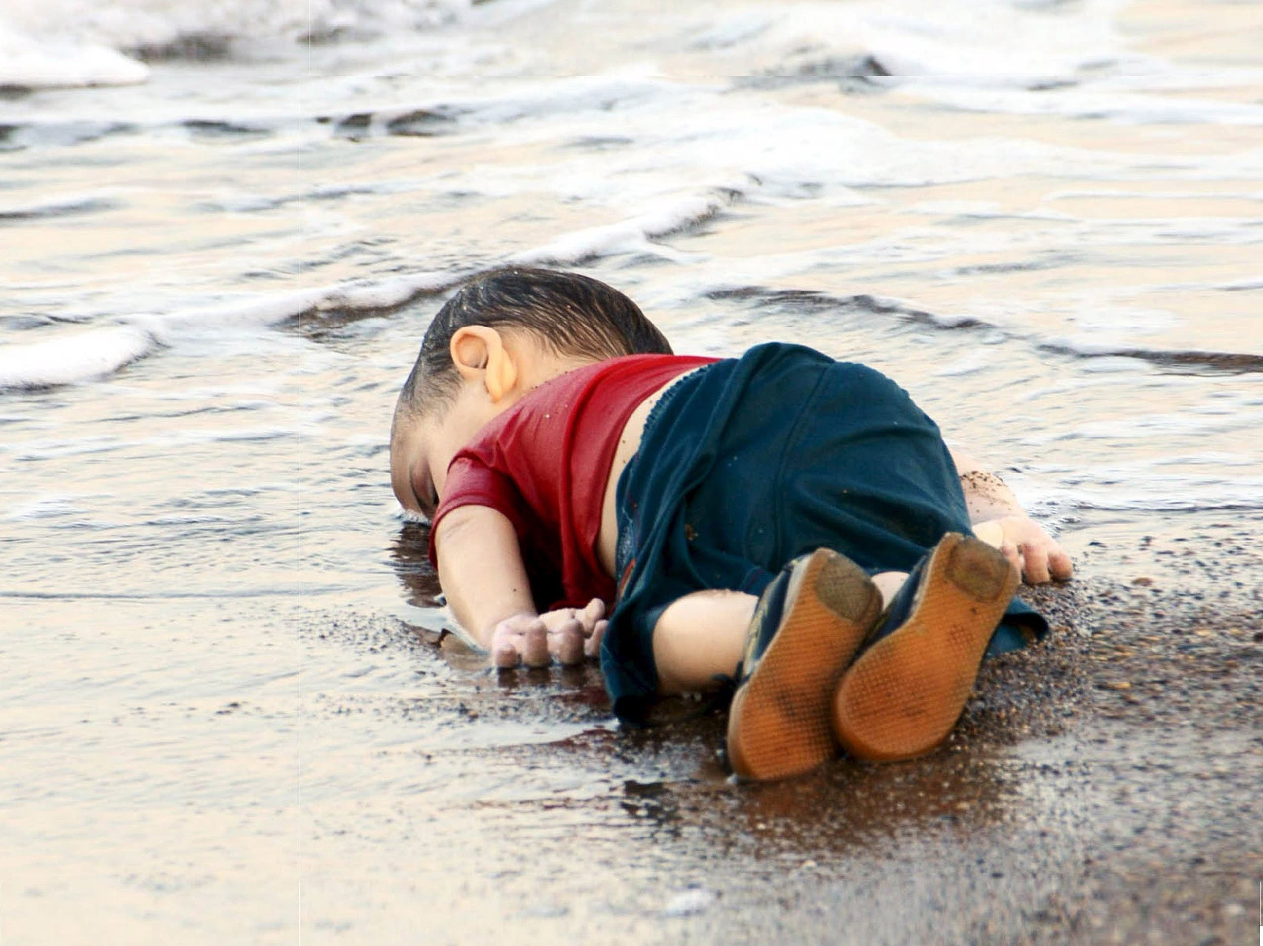 Aylan Kurdi drowned in a failed attempt to sail to the Greek island of Kos, lies on the shore in the Turkish coastal town of Bodrum, Turkey. (Reuters)