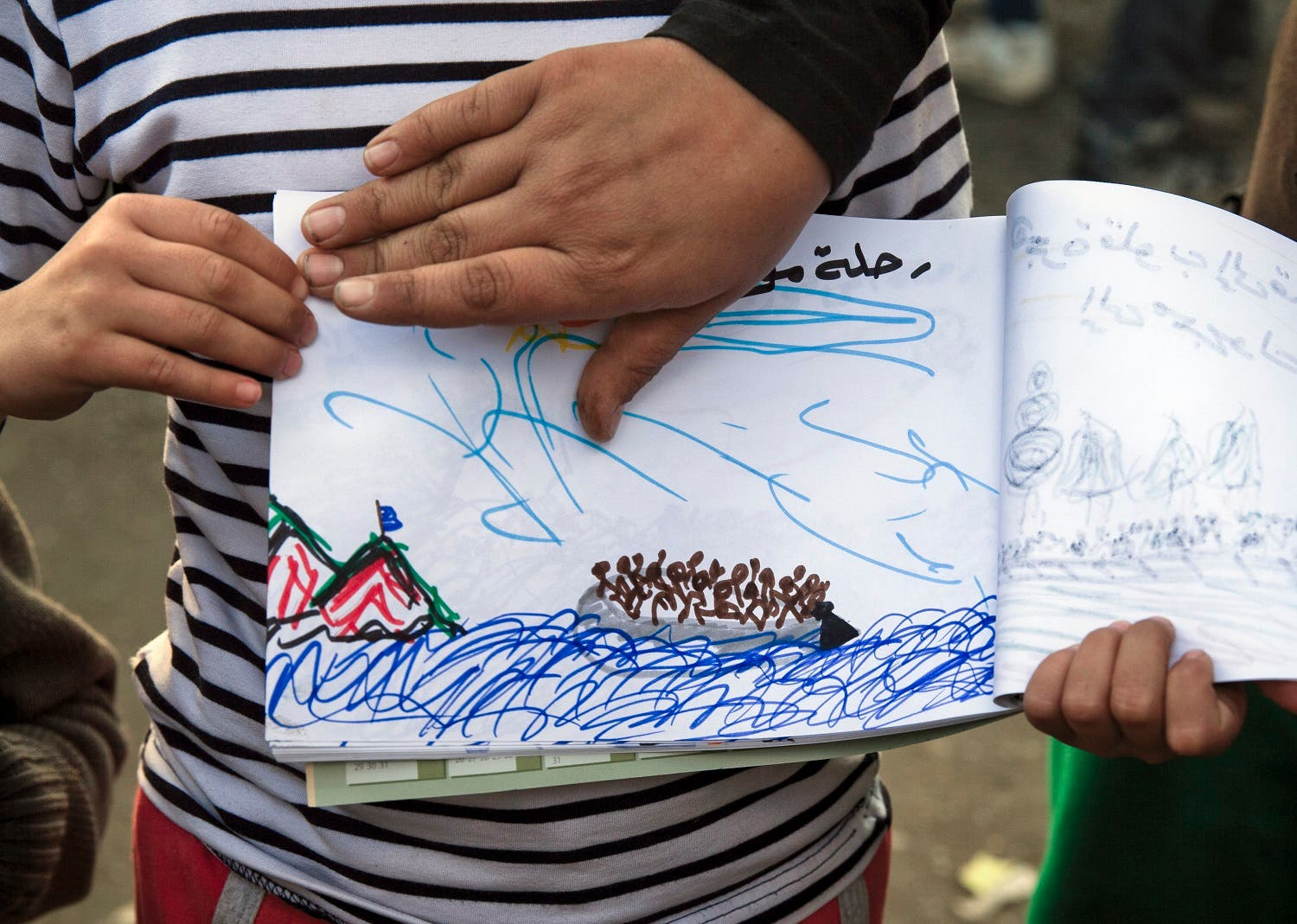Shaharzad Hassan, 8 year-old from the Syrian city of Aleppo poses with a drawing she made, at the northern Greek border station of Idomeni, Friday, March 11, 2016. At an overcrowded refugee camp on the Greek-Macedonian border, 8-year-old Shaharzad Hassan draws pictures of the harrowing events in her life over the past 18 months: Pictures of death in her home town of Aleppo, Syria, and her perilous journey to Europe. (AP Photo/Vadim Ghirda)