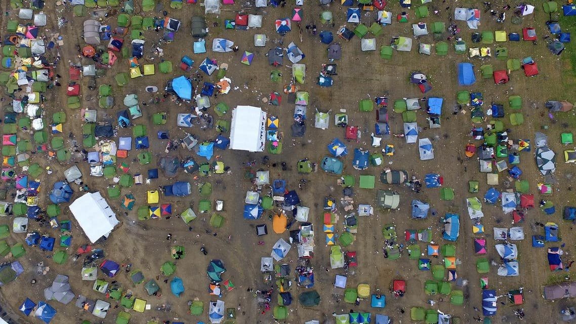 Tents of refugees and migrants stand next to a refugee camp at the Greek-Macedonian border, near the northern Greek village of Idomeni, Monday, March 7, 2016. At a summit in Brussels European Union leaders on Monday sought to press Turkey to do more to stop migrants from entering Europe and to shore up support for Greece, where thousands of people are stranded. (AP Photo/Eldar Emric)