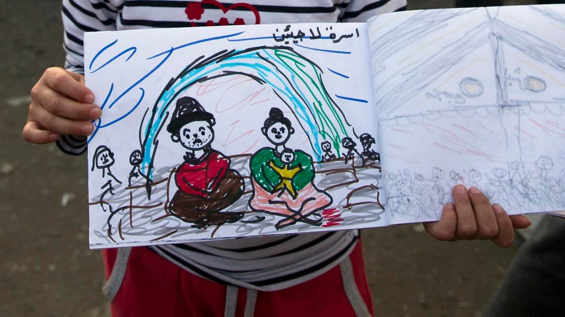 """Shaharzad Hassan, 8 year-old from the Syrian city of Aleppo poses with a drawing she made at the northern Greek border station of Idomeni, Friday, March 11, 2016. At an overcrowded refugee camp on the Greek-Macedonian border, 8-year-old Shaharzad Hassan draws pictures of the harrowing events in her life over the past 18 months: Pictures of death in her home town of Aleppo, Syria, and her perilous journey to Europe. The title, of this drawing seen top right reads """"Refugee family"""" .(AP Photo/Vadim Ghirda)"""