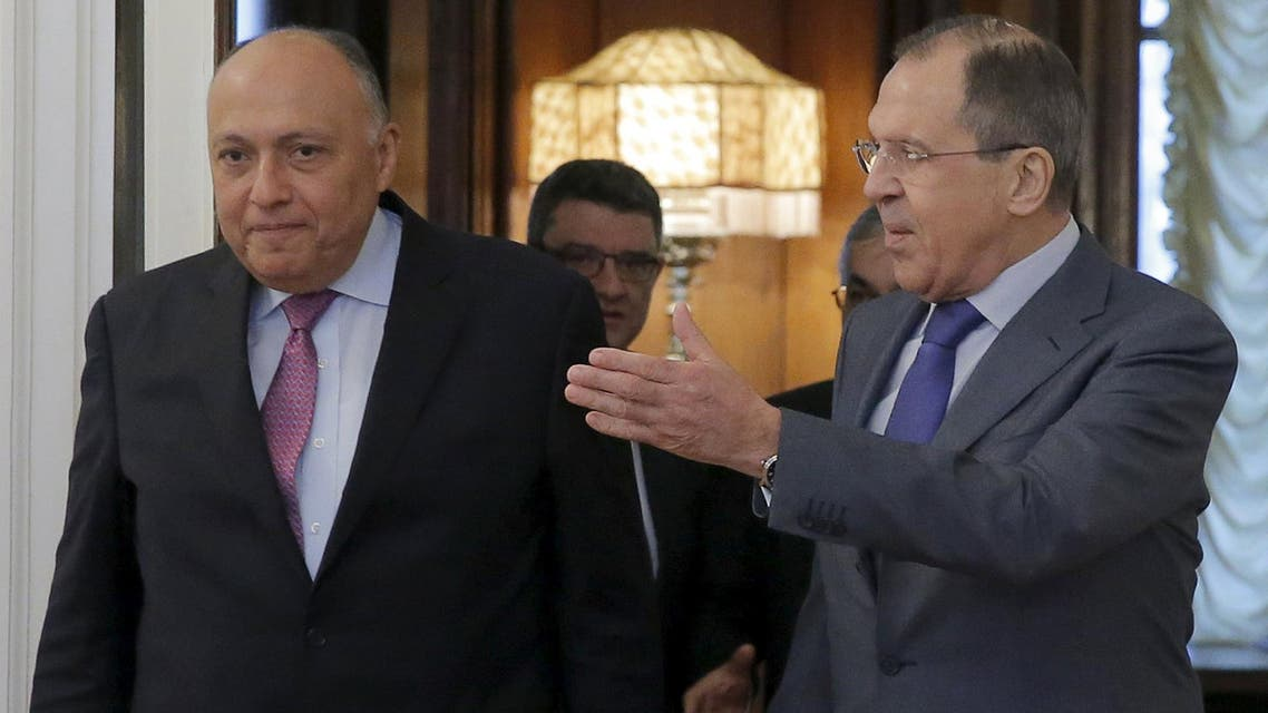 Russian Foreign Minister Sergei Lavrov (R) shows the way to his Egyptian counterpart Sameh Shukri during a meeting in Moscow, Russia, March 16, 2016. REUTERS