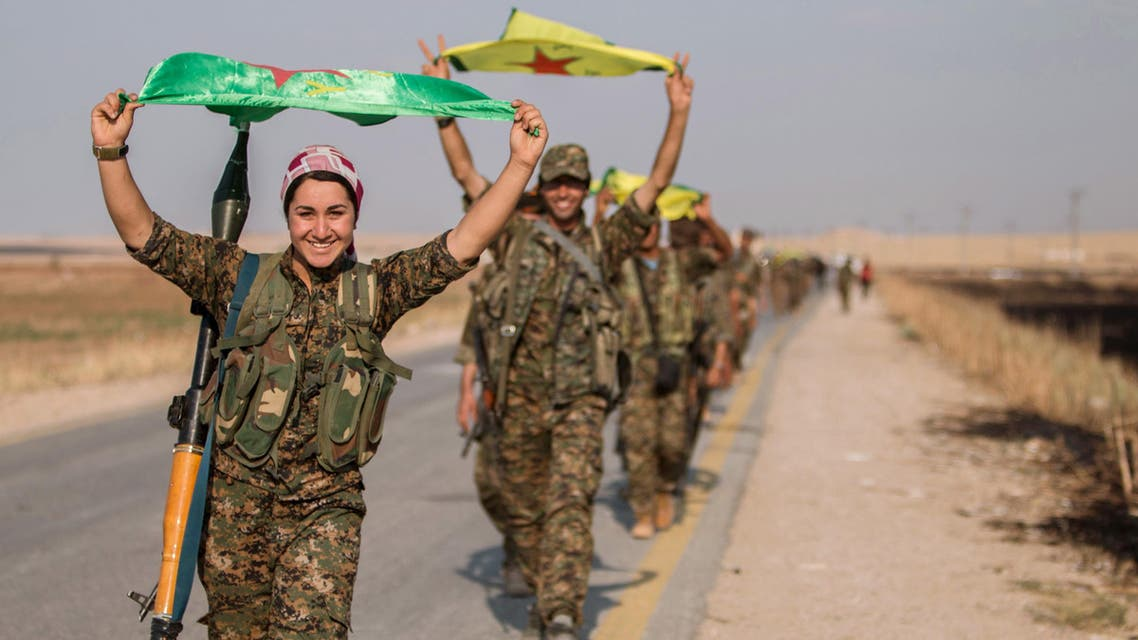 Kurdish fighters gesture while carrying their parties' flags in Tel Abyad of Raqqa governorate after they said they took control of the area June 15, 2015. (File photo: Reuters)