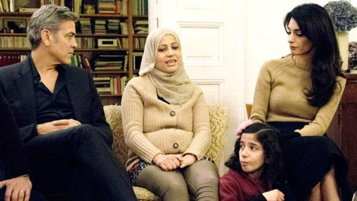 Hollywood actor George Clooney and his international human rights lawyer wife Amal met with Syrian refugee families. (Screenshot)
