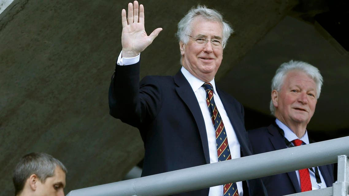 Britain's Defense Secretary Michael Fallon waves as he arrives at the Scottish Conservatives Conference at Murrayfield Stadium in Edinburgh, Scotland, Britain, March 4, 2016. Fallon's ministry has said there are no plans to extend bombing or send troops to Libya. (Reuters)