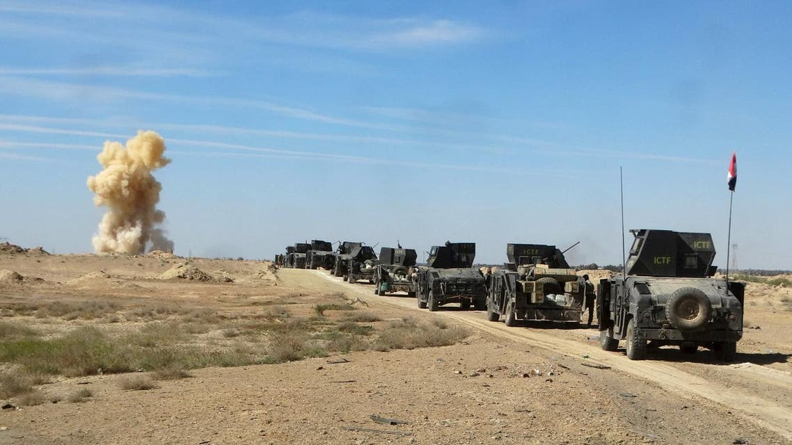 Iraqi security forces vehicles move toward the town of Hit during a military operation, in the west of Ramadi, March 8, 2016. Picture taken March 8, 2016. REUTERS/Stringer