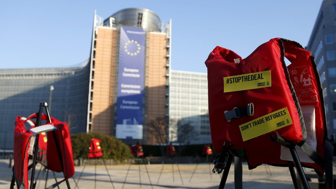 Lifejackets are pictured in front of the European Commission headquarters during a protest by Amnesty International to demand the European Council protect the human rights of the refugees within the EU-Turkey migration deal, ahead of an EU summit over migration in Brussels, Belgium, March 17, 2016. REUTERS/Francois Lenoir