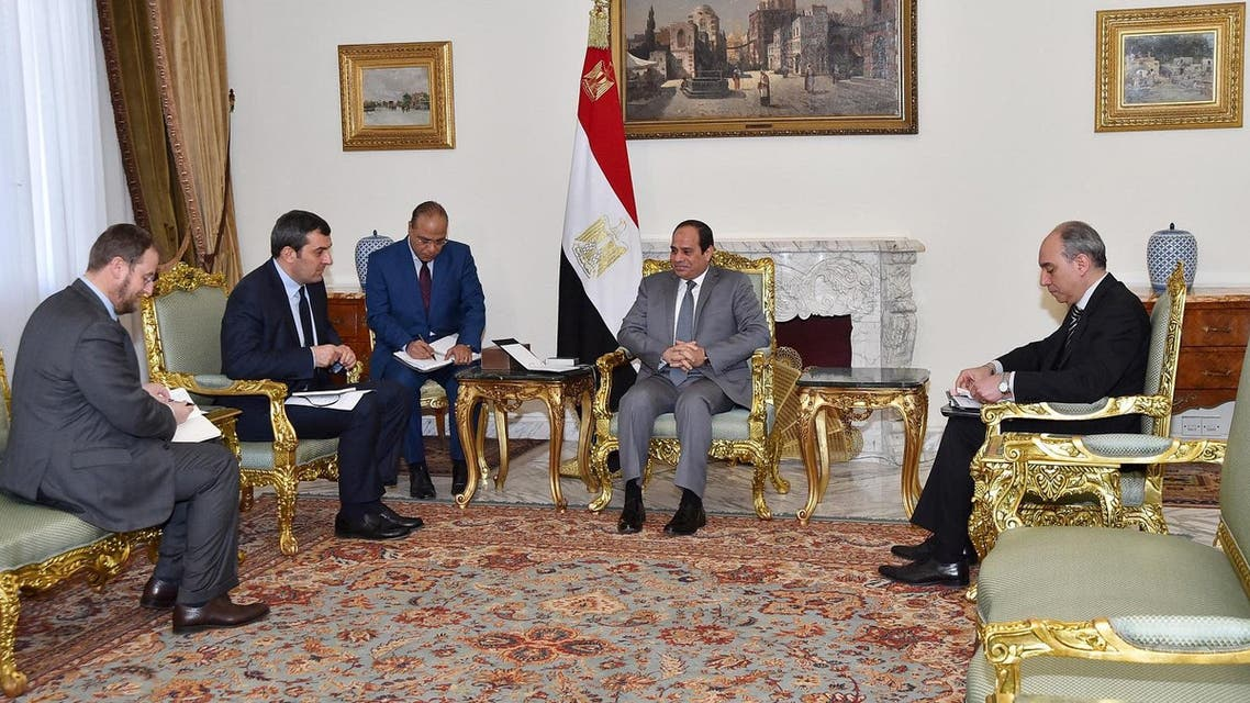 Egypt's President Abdel Fattah al-Sisi (2nd R) attends an interview with reporters of Italy's La Repubblica newspaper (L) at the Ittihadiya presidential palace in Cairo, Egypt, in this March 16, 2016 handout picture courtesy of the Egyptian Presidency. Egypt will spare no effort to find and punish those who tortured and killed Italian student Giulio Regeni in Cairo, Sisi said an interview published on Wednesday. REUTERS/The Egyptian Presidency