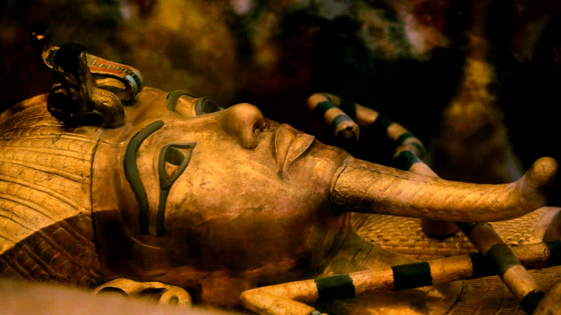 FILE - In this Thursday, Nov. 5, 2015 file photo, one of Egypt's famed King Tutankhamun's golden sarcophagus is displayed at his tomb in a glass case at the Valley of the Kings in Luxor. Egypt's Antiquities Minister Mamdouh el-Damaty, says during a press conference Thursday, March 17, 2016, that analysis of scans of famed King Tut's burial chamber has revealed two hidden rooms that could contain metal or organic material. (AP Photo/Amr Nabil)