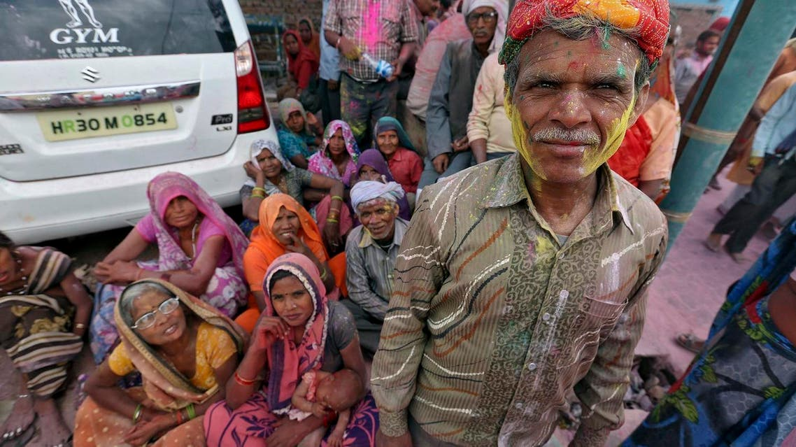Hindu devotees watch the religious festival of Lathmar Holi, where women beat the men with sticks, in the town of Barsana in the Uttar Pradesh region of India, March 17, 2016. (Photo:  REUTERS)
