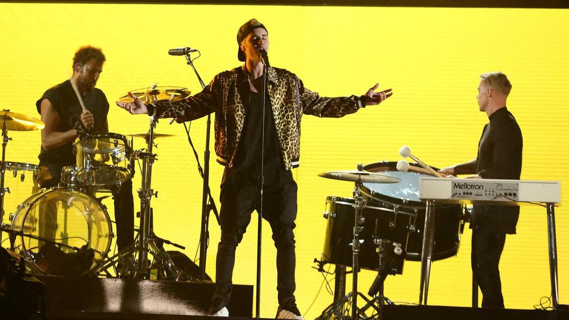Justin Bieber, center, performs with Jack U at the 58th annual Grammy Awards on Monday, Feb. 15, 2016, in Los Angeles. (AP)