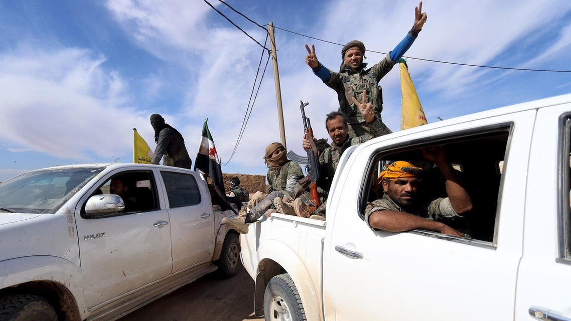 Syria Democratic Forces and Free Syrian Army fighters gesture on the back of pick-up trucks in a village on the outskirts of al-Shadadi town, Hasaka countryside, Syria February 19, 2016. REUTERS/Rodi Said