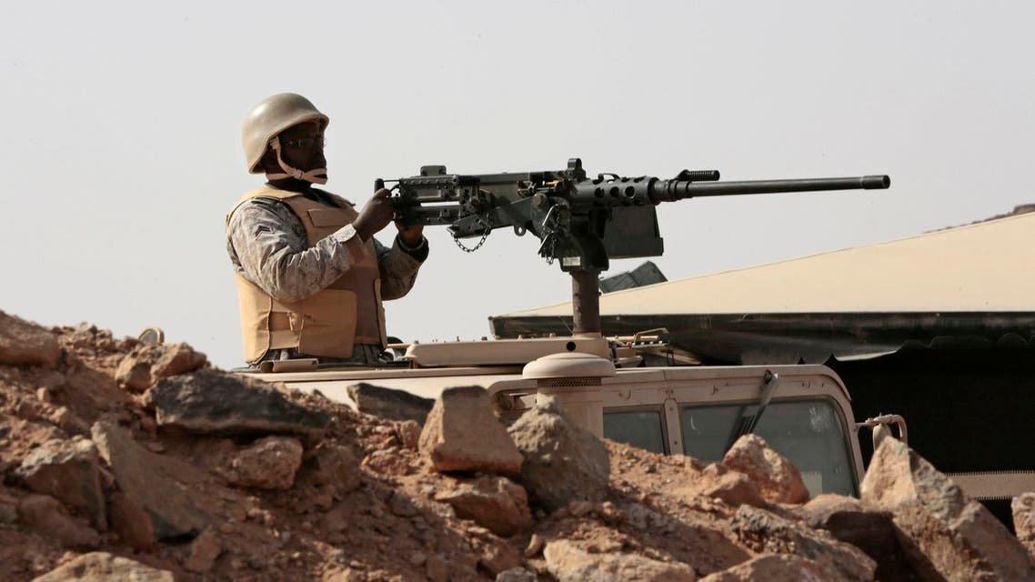 A Saudi soldier sits on top of an armor vehicle as he aims his weapons, on the border with Yemen. (File photo: AP)