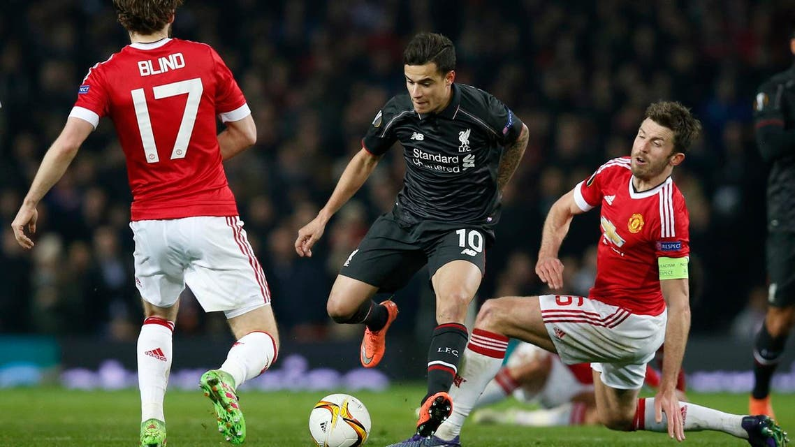 Football Soccer - Manchester United v Liverpool - UEFA Europa League Round of 16 Second Leg - Old Trafford, Manchester, England - 17/3/16 Liverpool's Philippe Coutinho in action with Manchester United's Michael Carrick and Daley Blind. (Reuters)