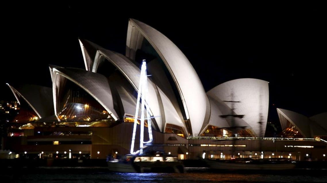 The lights of the Sydney Opera House can be seen before they were switched off for Earth Hour in Sydney, Australia, March 19, 2016 (Reuters)