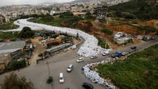 Lorries begin moving Beirut's mountains of trash to landfill