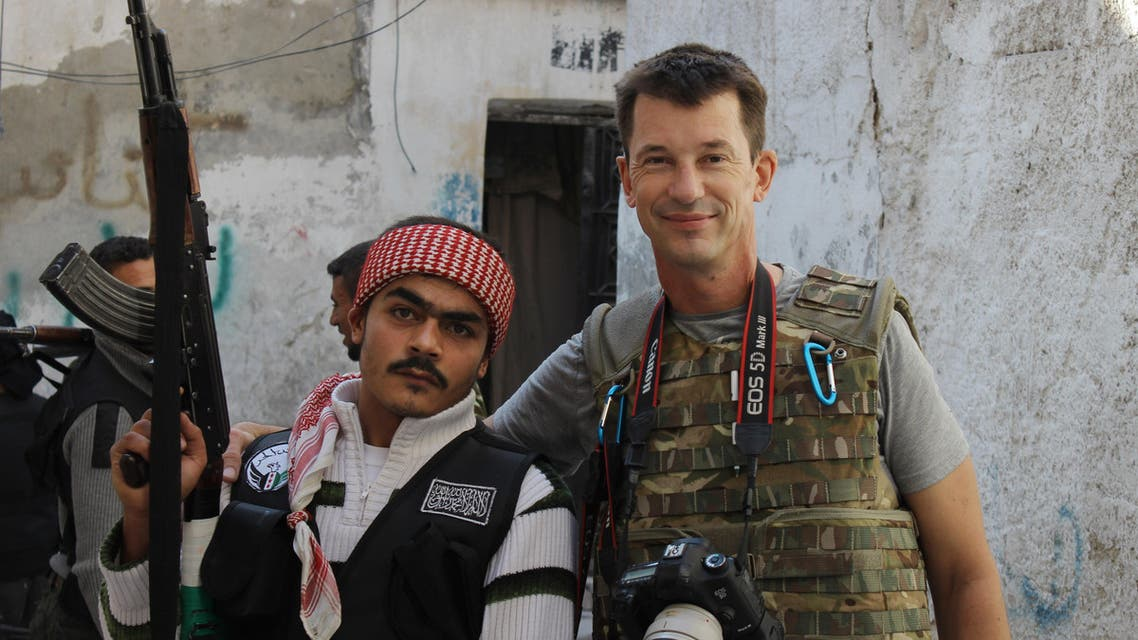 In this Nov. 11, 2012 file photo, freelance British photojournalist John Cantlie poses with a Free Syrian Army rebel in Aleppo, Syria. AP