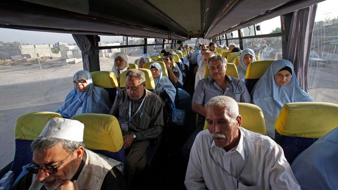 Muslim pilgrims wait inside a bus en route to Rafah border between Gaza Strip and Egypt before leaving for the annual hajj pilgrimage to the holy city of Mecca, in Gaza City, early Wednesday, Oct. 2, 2013. AP