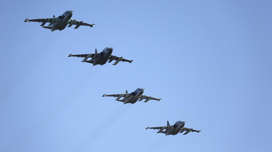 Russian Sukhoi Su-25 fighter jets fly in formation after returning from Syria, before landing at an airbase in Krasnodar region, southern Russia, in this March 16, 2016 handout photo by the Russian Ministry of Defence. REUTERS