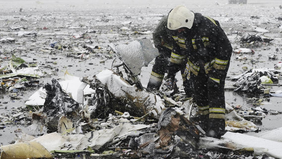 Emergencies Ministry members search the wreckage at the crash site of Flight number FZ981, a Boeing 737-800 operated by Dubai-based budget carrier Flydubai, at the airport of Rostov-On-Don, Russia. (Reuters)