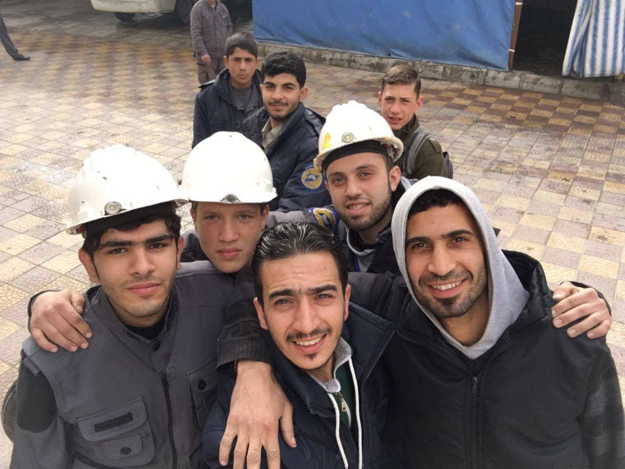 Mahmoud Adam, a worker from the White Helmets attends a party for the orphans in Douma, Syria.