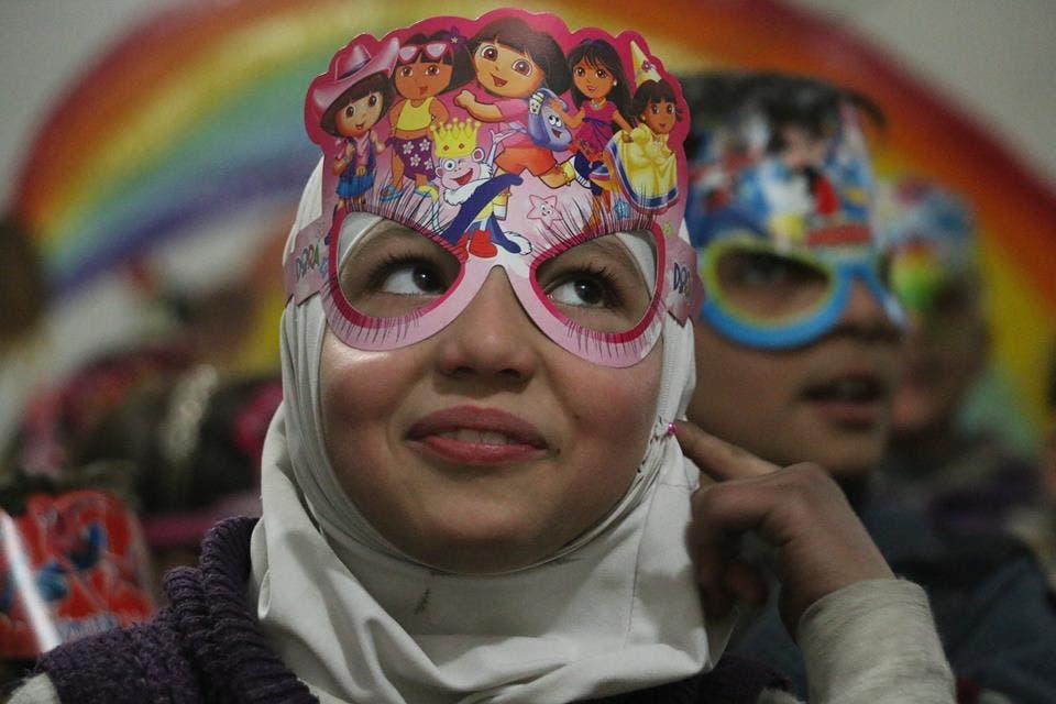 Children celebrate at the center for orphans in Douma, Syria. (Photo credit: Samer Bouidani)