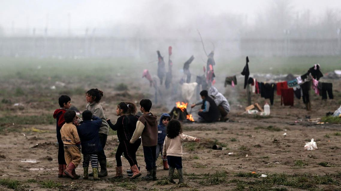 Refugee children play at a makeshift camp for refugees and migrants at the Greek-Macedonian border near the village of Idomeni, Greece, March 18, 2016. REUTERS
