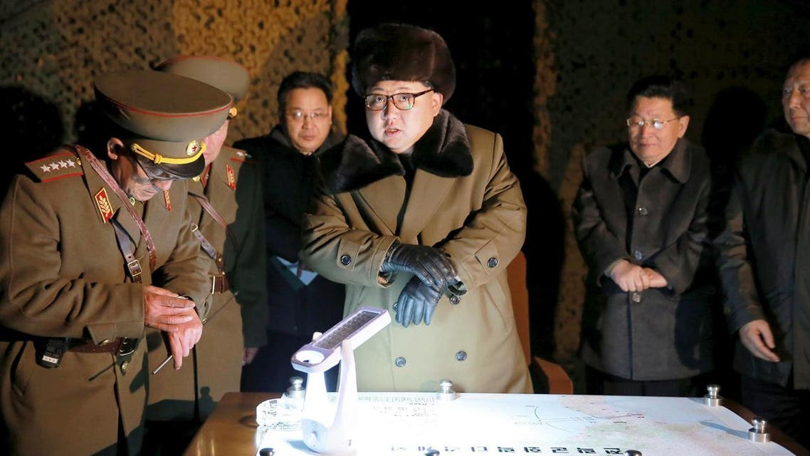 North Korean leader Kim Jong Un talks with officials at the ballistic rocket launch drill of the Strategic Force of the Korean People's Army (KPA) at an unknown location, in this undated photo released by North Korea's Korean Central News Agency (KCNA) in Pyongyang on March 11, 2016. (Reuters/KCNA)