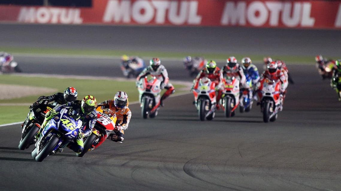 Italian MotoGP rider Valentino Rossi of the Movistar Yamaha MotoGP team, front, steers his bike during a final session of the Moto GP World Championship at the Losail International Circuit in Doha, Qatar, Sunday, March 29, 2015. (AP)