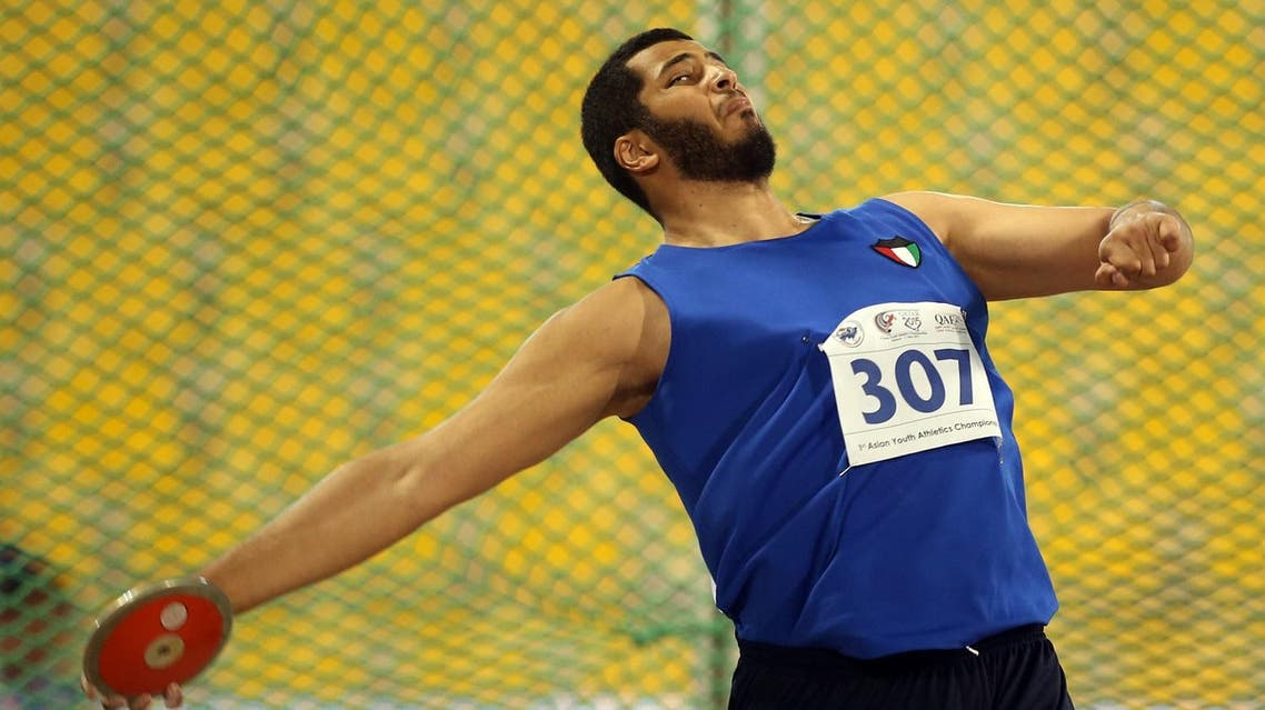Husain Al Salem of Kuwait throws the discus at the Asian Youth Athletics Championships in Doha, Qatar, Monday, May 11, 2015. (AP)