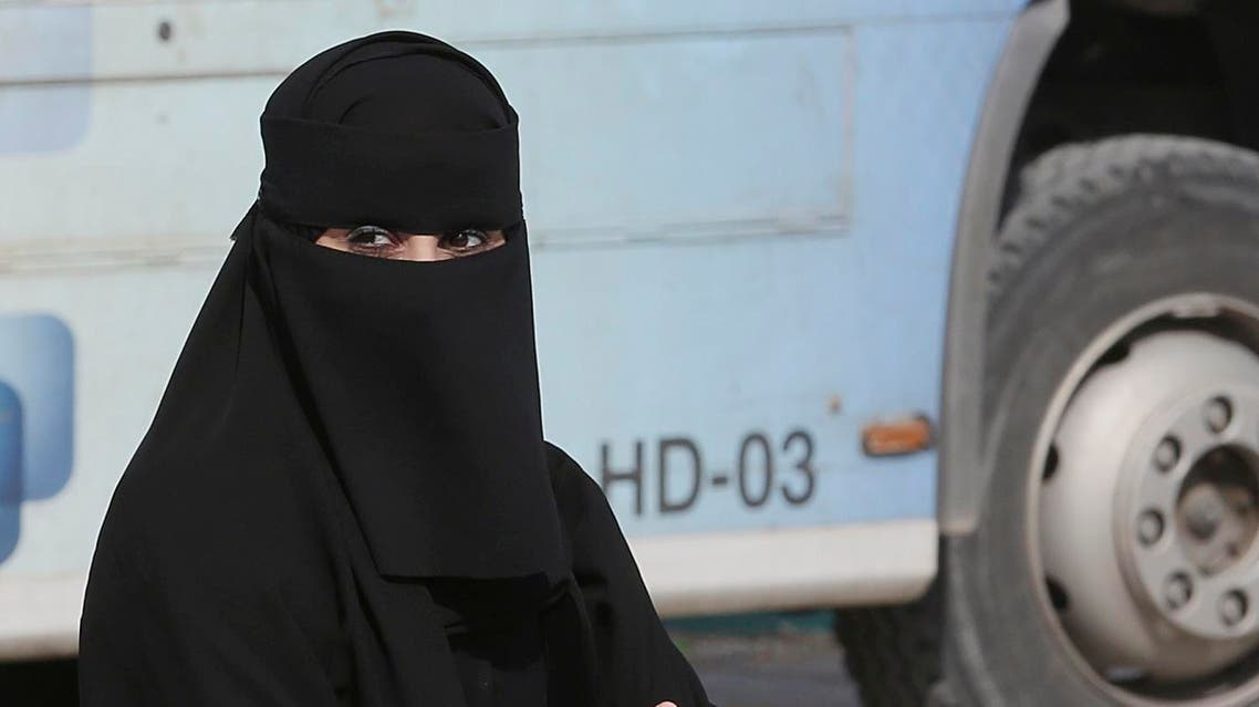 A Saudi woman waits outside a polling center as she prepares to cast her ballot during the country's municipal elections in Riyadh, Saudi Arabia, Saturday, Dec. 12, 2015. (AP)