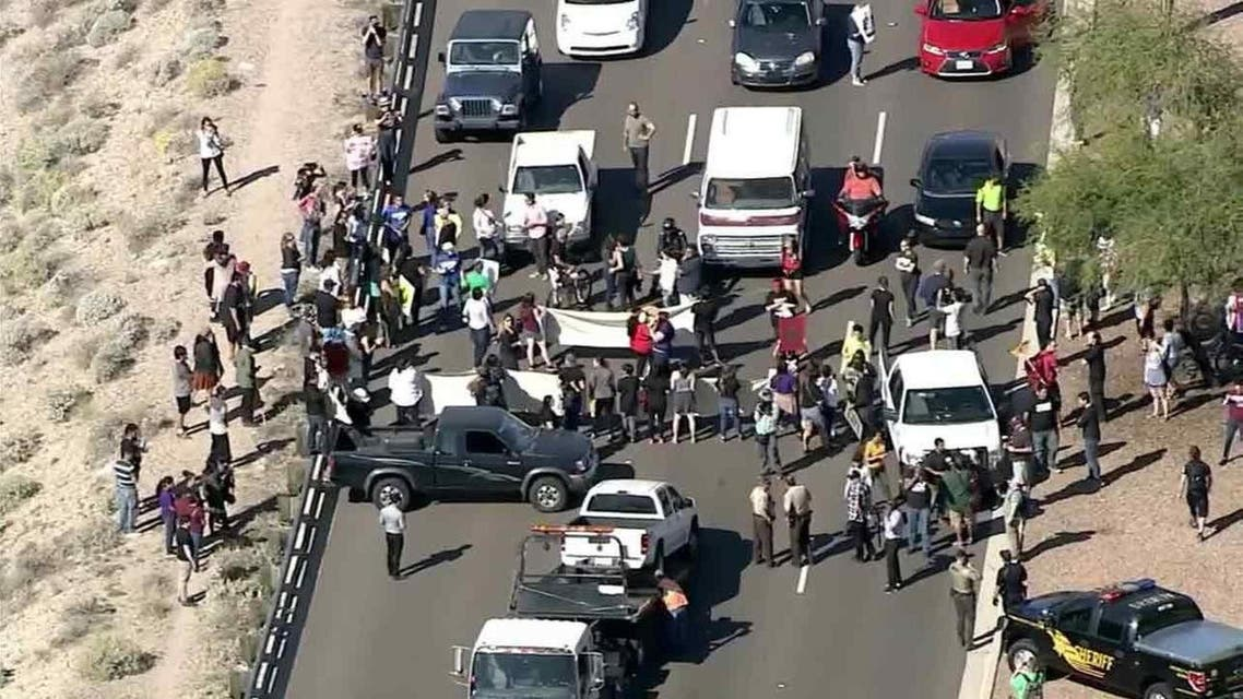 Protesters were blocking a main highway leading into the Phoenix suburb where Republican presidential front-runner Donald Trump is set to hold a campaign rally. (Photo courtesty: KNBC)