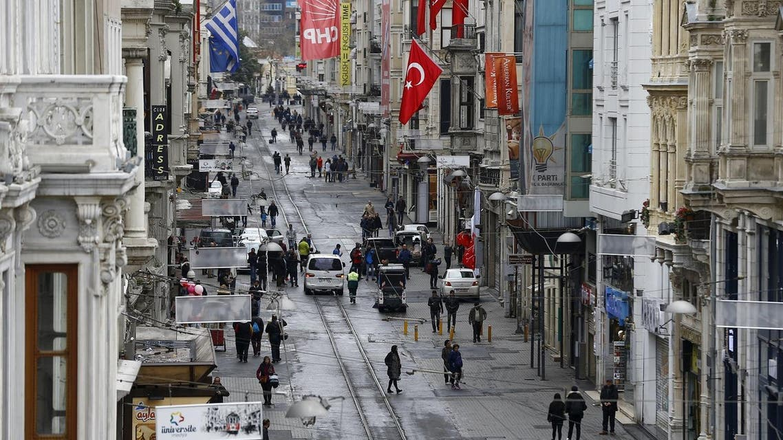 Pedestrians walk along Istiklal street, a major shopping and tourist district, in central Istanbul, Turkey March 20, 2016, a day after a suicide bomb attack. REUTERS/Osman Orsal