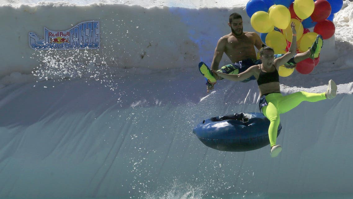 Participants jump and freeze at Red bull competition