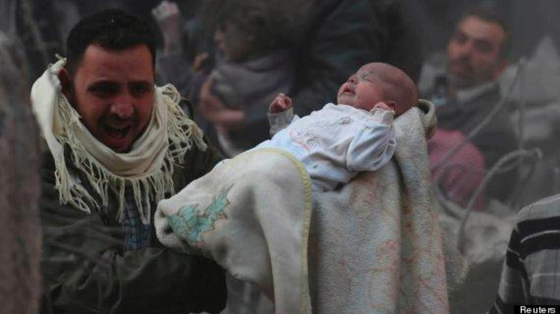 The White Helmets save a 2-month-old baby from under the rubbles, after the Ansari neighborhood in Aleppo, Syria, was targeted with Assad's barrel bombs. (Reuters)