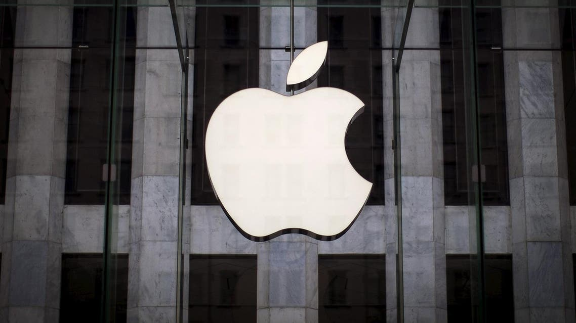 An Apple logo hangs above the entrance to the Apple store on 5th Avenue in the Manhattan borough of New York City. (Reuters)