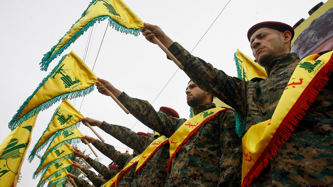 FILE - In this Wednesday, March 2, 2016 photo, Hezbollah fighters hold flags as they attend the funeral procession of Hezbollah senior commander, Ali Fayyad, who was killed last week during an offensive by Syrian troops and Hezbollah fighters in Syria, in the southern Lebanese village of Ansar, Lebanon. Fayyad was a Hezbollah veteran who had led major battles against the Israeli army in south Lebanon. A Saudi-led bloc of six Gulf Arab nations formally branded Hezbollah a terrorist organization on Wednesday, ramping up the pressure on the Lebanese militant group fighting on the side of President Bashar Assad in Syria. (AP Photo/Mohammed Zaatari, File)