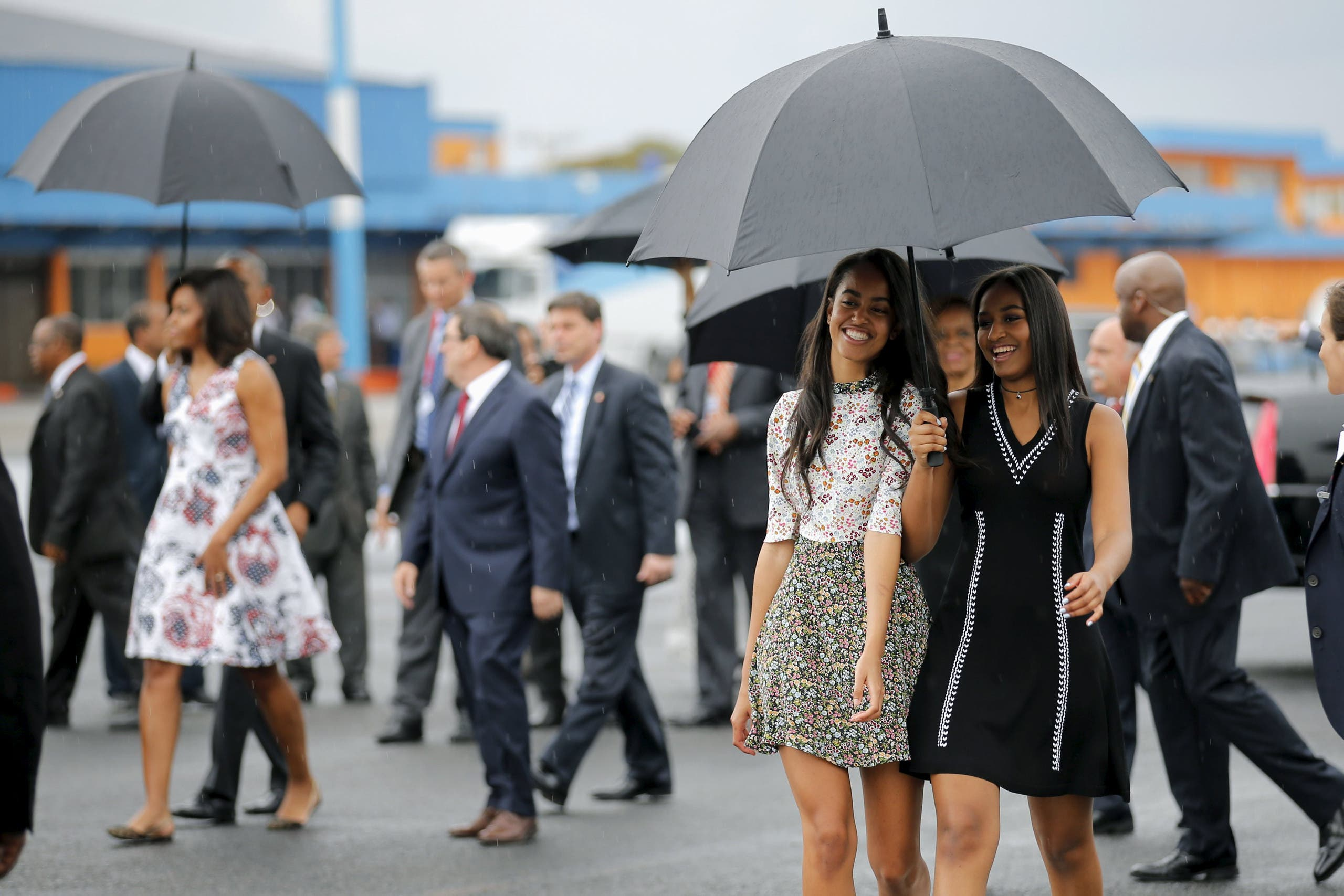 Obama's daughters Malia and Sasha arrive with their parents at the Jose Marti international airport at the start of a three-day visit to Cuba, in Havana. (Reuters)