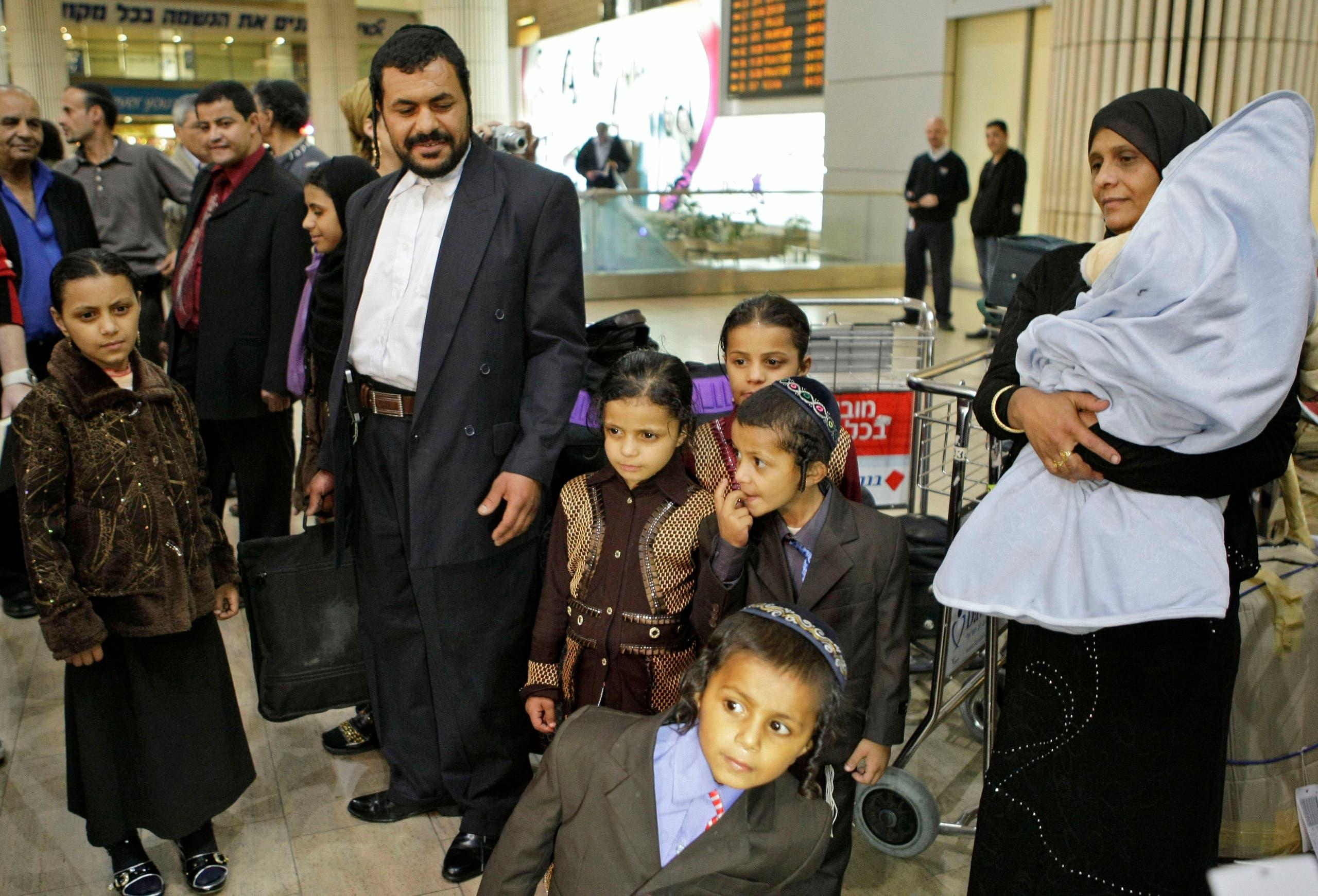 Yemenite Jews Said Ben Yisrael, second left, his wife Simha, right, and their children arrive at Ben Gurion airport near Tel Aviv, Israel, Thursday, Feb. 19, 2009. (AP)