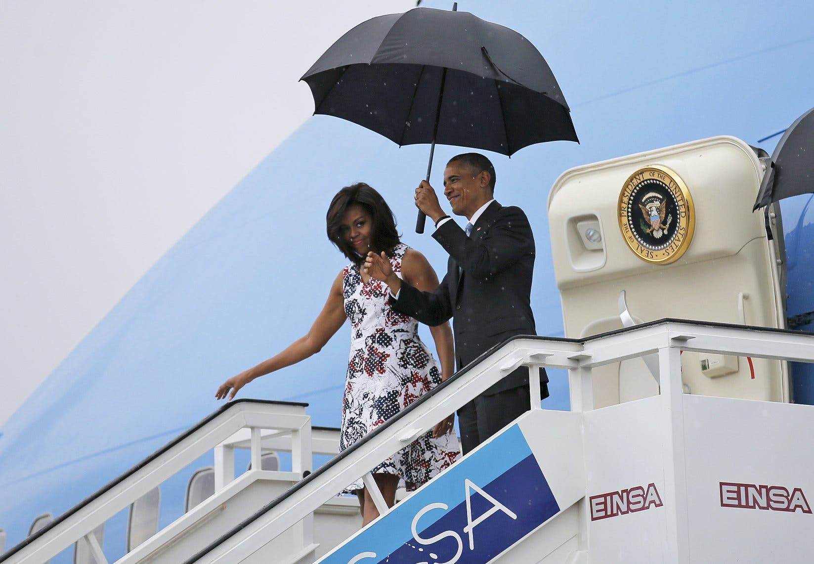 U.S. President Barack Obama and his wife Michelle exit Air Force One as they arrive at Havana's international airport for a three-day trip, in Havana March 20, 2016.  reuters