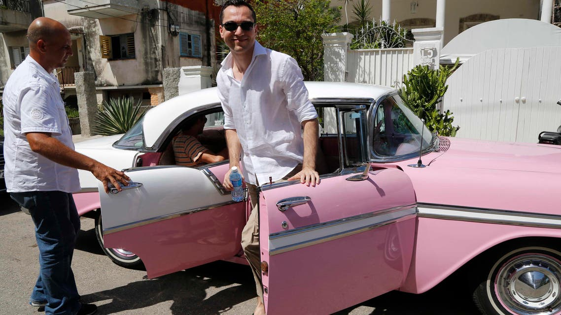 Co-founder of Airbnb Nathan Blecharczyk gets out of a classic American car taxi as he arrives to the guesthouse of Armando Usain in Havana, Cuba, Wednesday, June 24, 2015. During his first trip to Havana, Blecharczyk said that AirBnb had requested a special license allowing people from outside the US to use the San Francisco-based business to reserve stays at private homes inside Cuba. (AP)