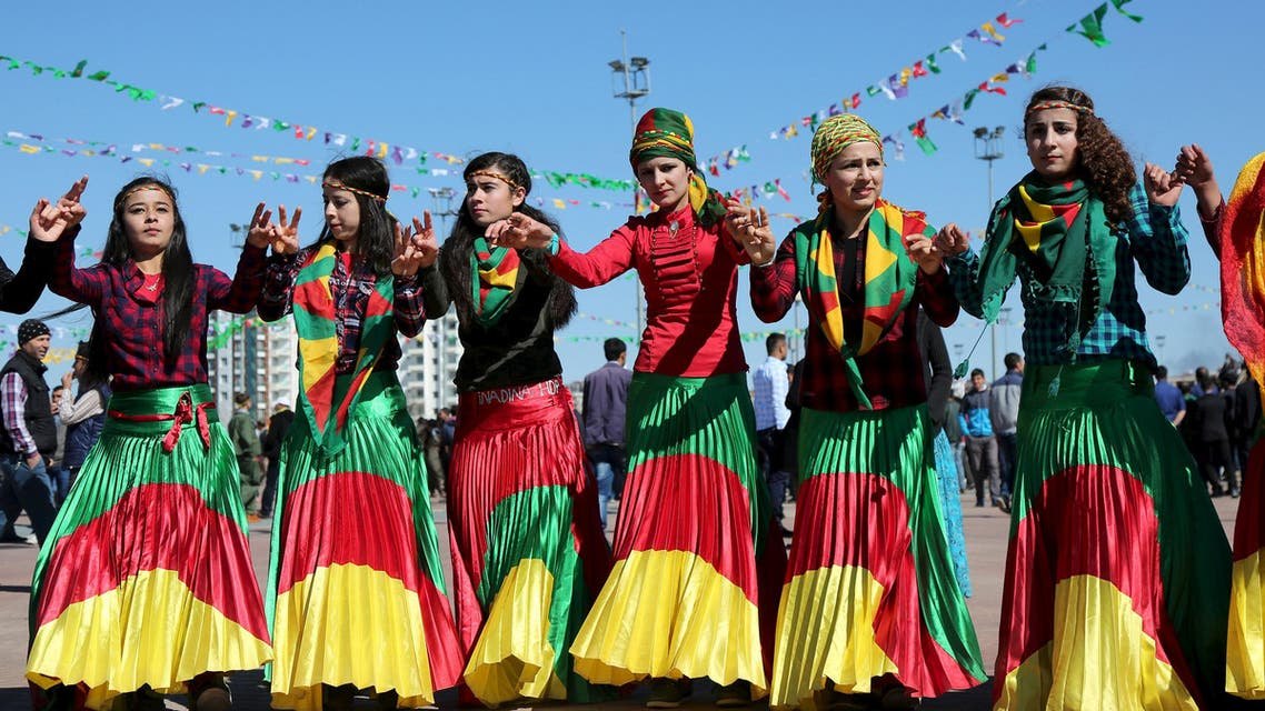 Women wearing traditional dresses, dance during a gathering to celebrate the spring festival of Newroz in the Kurdish-dominated southeastern city of Diyarbakir, Turkey March 21, 2016. reuters