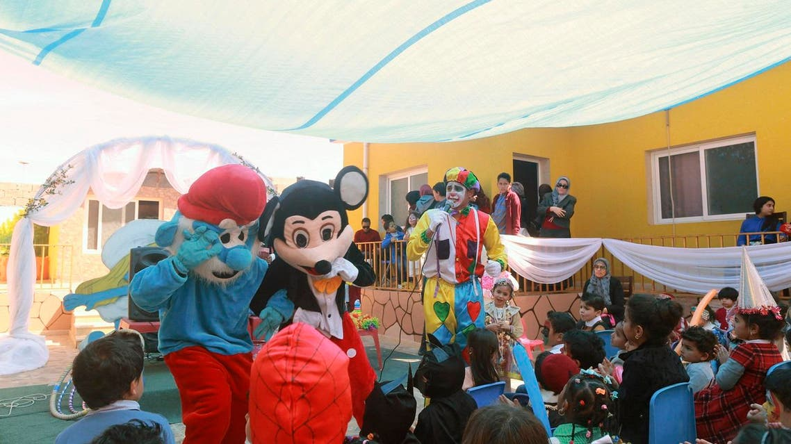 Children are entertained by men dressed as cartoon characters during Children's Day celebrations at a school in Benghazi, Libya March 21, 2016. (Photo: Reuters)