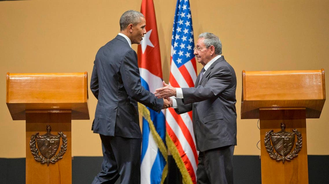 President Barack Obama and Cuban President Raul Castro shake hands at the conclusion of their joint news conference at the Palace of the Revolution, Monday, March 21, 2016 in Havana, Cuba. (AP)