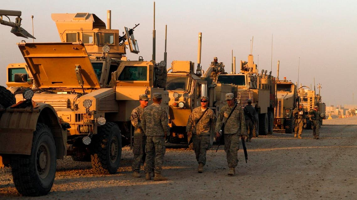 In this Saturday, Dec. 17, 2011 photo, U.S. Army soldiers from 3rd Brigade, 1st Cavalry Division, based at Fort Hood, Texas, stage their armored vehicles at Camp Adder during final preparations for the last American convoy to leave Iraq. (File photo: AP)