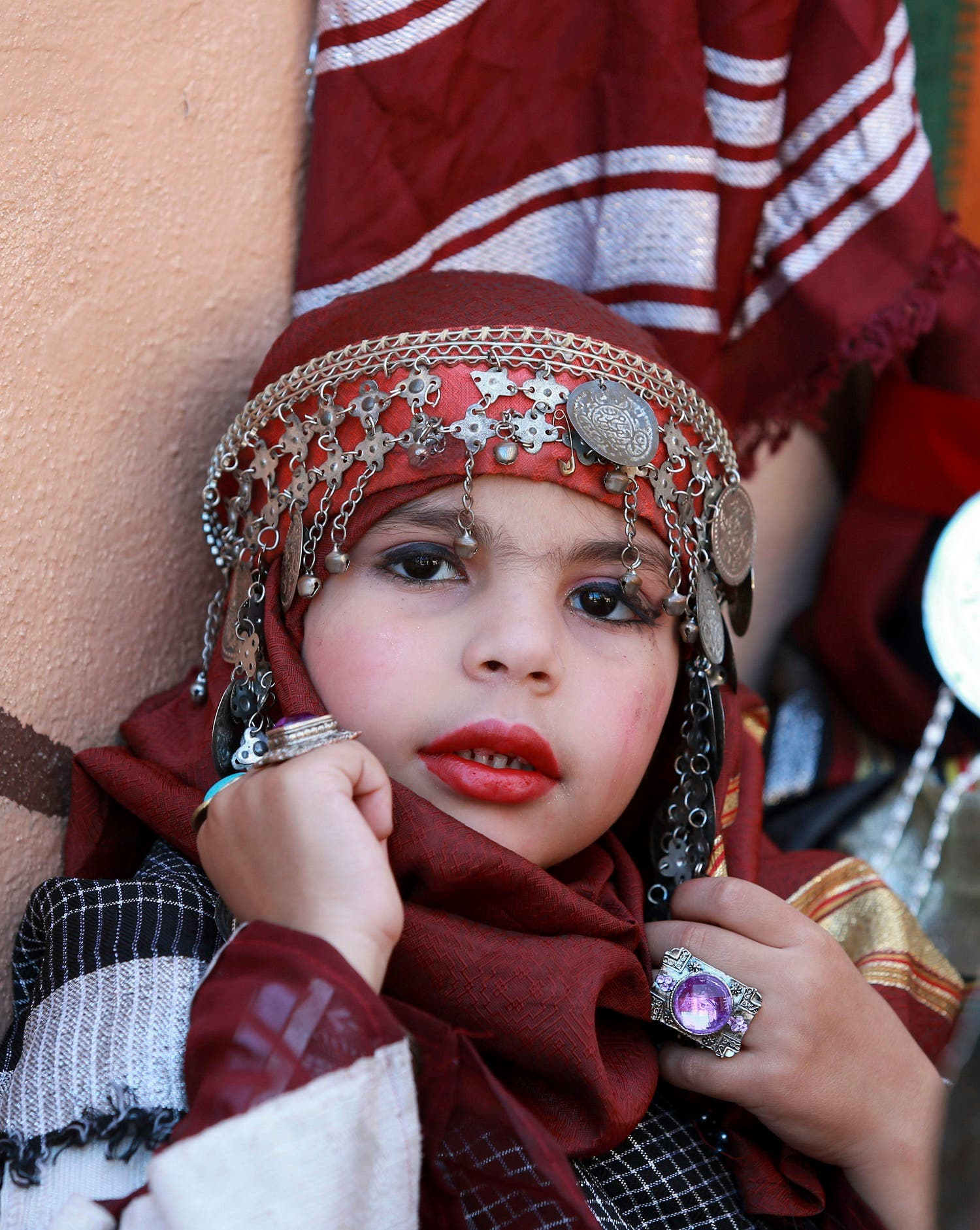 A girl wears a traditional costume during Children's Day celebrations at a school in Benghazi, Libya March 21, 2016. (Photo: Reuters)