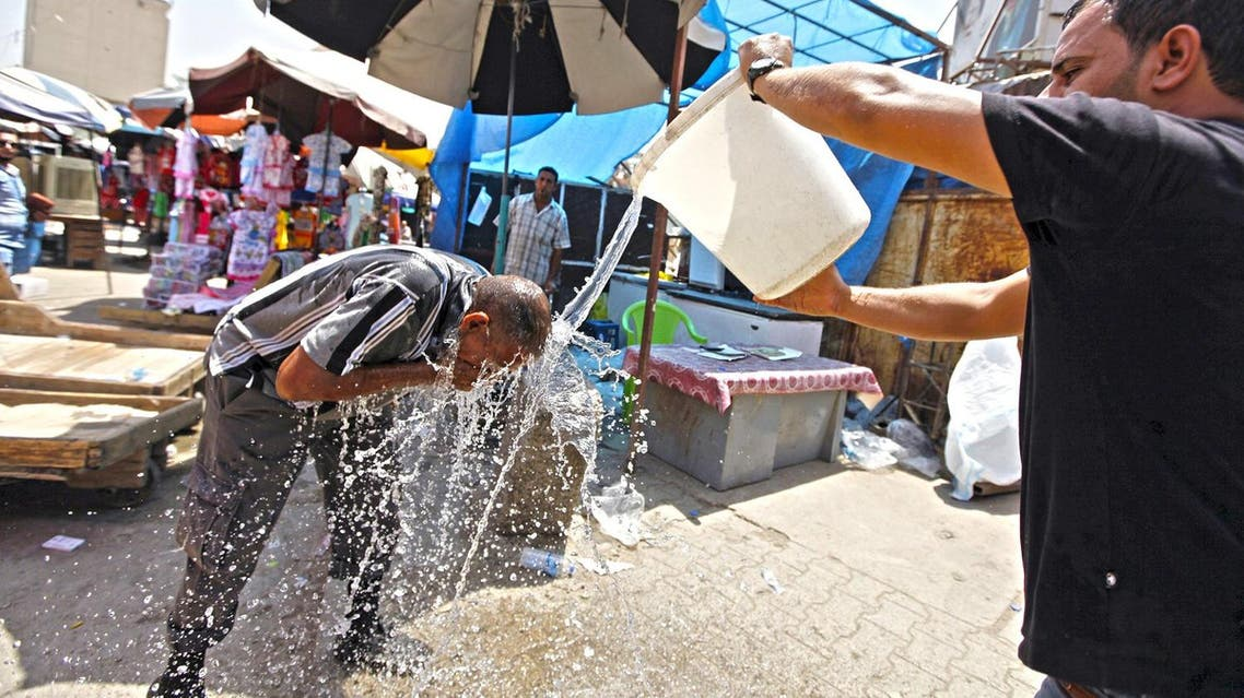 A man cools off during a warm summer day in Baghdad July 30, 2015. (File photo: Reuters)